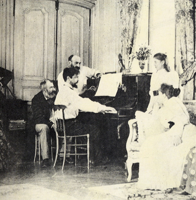 debussy at the piano in front of the composer ernest chausson 1893