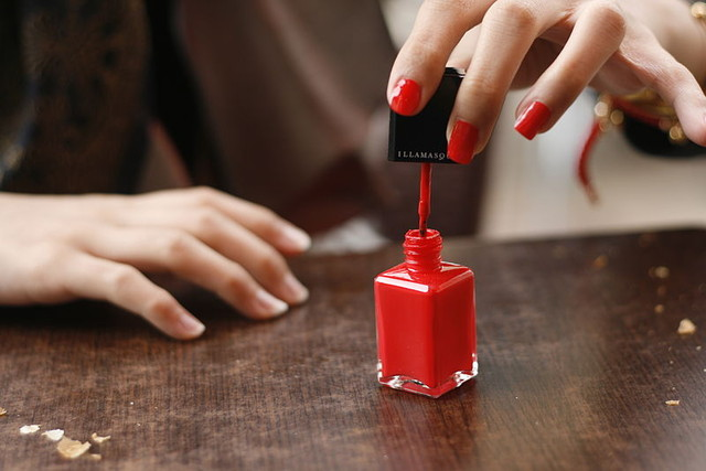 800px Red nail polish in application