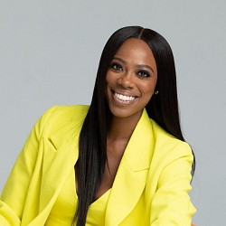 Actor Yvonne Orji Wearing A Yellow Blazer